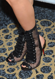 Ksenia Solo rocked black Christian Louboutin gladiator heels at Comic-Con 2012.