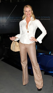 Nicollette Sheridan was a vision in neutrals, carrying a furry stud embellished bag.