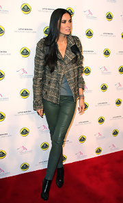 Demi Moore stepped onto the red carpet in a plaid pea coat with green leather leggings for the Lotus Cars Launch event.
