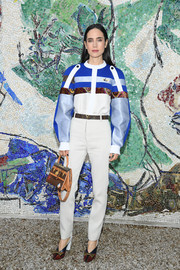 Jennifer Connelly was sporty in a paneled blouse by Louis Vuitton during the label's Cruise 2019 show.