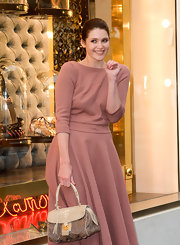 Gemma Arterton showed off her off the runway satchel while attending the Bond Street Maison Launch.