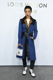 Ruth Negga was rocker-glam in a blue suede coat with black leather trim at the Louis Vuitton boutique opening in Paris.