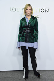 Cate Blanchett attended the Louis Vuitton opening wearing a green blazer with black leather trim.