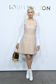 Michelle Williams teamed her dress with white ankle boots, which amped up the retro feel.