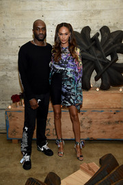 Joan Smalls matched her top with a pair of printed ankle-tie sandals.