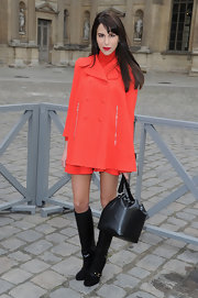 A pair of black Louis Vuitton knee-high boots amped up the retro-chic feel of Caroline Sieber's look.