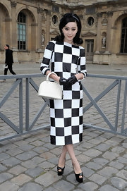 Fan Bingbing was all about black and white at the Louis Vuitton runway show in Paris with this bold checkered dress.