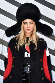 Chiara Ferragni caught stares with this oversized fur hat by Louis Vuitton during the label's Spring 2017 show.