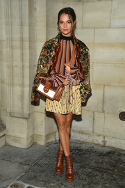 Alicia Vikander accessorized with a stylish tricolor satchel by Louis Vuitton.