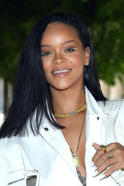 Rihanna sported a solid white mani to complement her outfit and eye makeup.