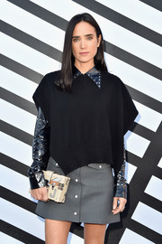 Jennifer Connelly accessorized with a printed box clutch by Louis Vuitton when she attended the label's Spring 2017 show.