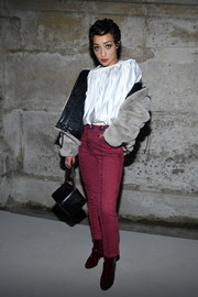 Ruth Negga attended the Louis Vuitton Fall 2018 show wearing a white satin peasant blouse from the brand.