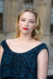 Haley Bennett looked oh-so-lovely at the Louis Vuitton fashion show with her slicked-back curls.