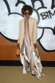 Naomi Campbell added a masculine-chic touch with a nude blazer.