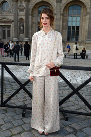 "Antonine Peduzzi was ""pajama-chic"" in floral pants and a matching blouse at the Louis Vuitton fashion show."