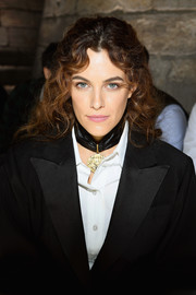 Riley Keough looked youthful and cute wearing her hair in a cascade of curls at the Louis Vuitton Spring 2018 show.