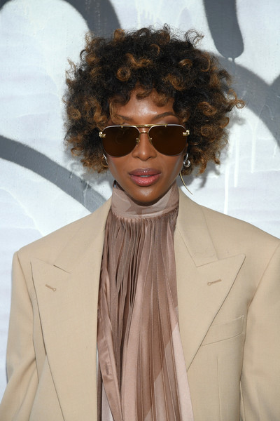 Naomi Campbell hid her eyes behind a pair of classic aviators.