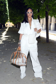 Rihanna went for funky styling with a see-through duffle, also by Louis Vuitton.