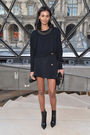 Liya Kebede coordinated her top with a black wraparound mini skirt, also by Louis Vuitton.