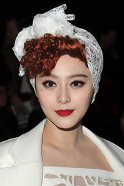 Fan Bingbing attended the Louis Vuitton fall 2012 fashion show wearing a classic matte red lipstick.