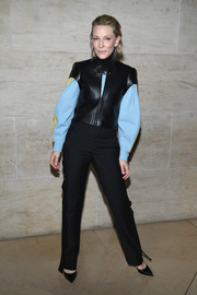 Cate Blanchett looked ultra modern in a short-sleeve black leather jacket layered over a pastel-blue top, both by Louis Vuitton, during the brand's Spring 2018 show.
