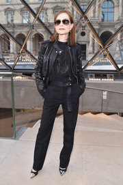 Isabelle Huppert looked agelessly cool in a black leather jacket layered over a semi-sheer blouse at the Louis Vuitton fashion show.