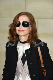 Isabelle Huppert looked oh-so-cool wearing these studded square shades at the Louis Vuitton Spring 2019 show.
