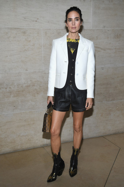 Jennifer Connelly styled her look with a pair of black and gold cowboy boots by Louis Vuitton.
