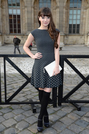 Hailee Steinfeld attended the Louis Vuitton fashion show wearing a chic fit-and-flare print dress.