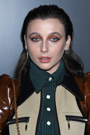 Emma Chamberlain made sure her beauty look took center stage by piling on the eyeshadow for the Louis Vuitton Fall 2020 show.