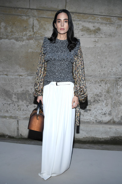 Jennifer Connelly completed her outfit with a flowing white skirt, also by Louis Vuitton.