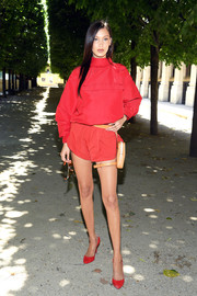 Bella Hadid bundled up in a loose red turtleneck for the Louis Vuitton Menswear Spring 2019 show.