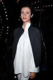 Garance Dore layered a multitextured zip-up jacket over a loose white blouse for the Louis Vuitton fashion show.