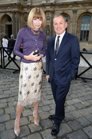 Anna Wintour looked classy, as always, in a purple twinset and a floral skirt during the Louis Vuitton fashion show.