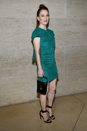 Julianne Moore looked simply chic in a jade-green Louis Vuitton suede dress with a fringed back during the brand's Spring 2018 show.