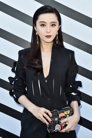 Fan Bingbing teamed a printed box clutch with a slashed pantsuit, both by Louis Vuitton, for the brand's Spring 2017 show.