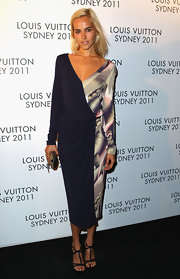Isabel Lucas wore a draped knit print dress for the Louis Vuitton Maison reception.
