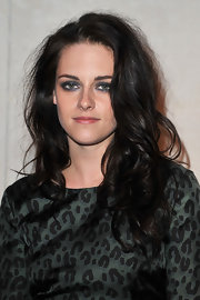 Kristen Stewart wore her hair in messy waves and curls while in Paris for fashion week.
