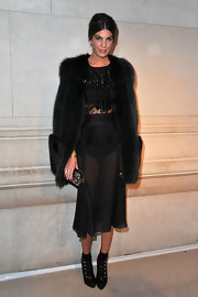 Bianca Brandolini was daring at the Louis Vuitton exhibition in Paris wearing this sheer lace dress.