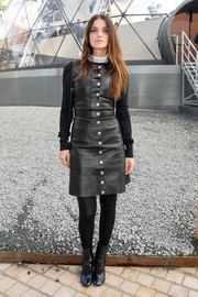 Joana Preiss amped up the edge factor in a Louis Vuitton leather LBD adorned with silver buttons down the front.