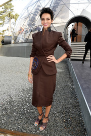Farida Khelfa was all business in a brown skirt suit during the Louis Vuitton fashion show.