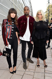 Miroslava Duma looked super cool in a red and black striped leather jacket by Louis Vuitton during the label's fashion show.