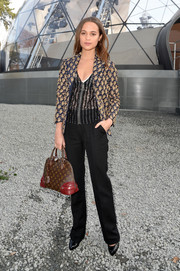Alicia Vikander was office-chic in a printed blazer teamed with black slacks at the Louis Vuitton fashion show.