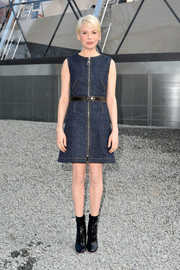 Michelle Williams sealed off her mod look with a pair of black patent boots, also by Louis Vuitton.