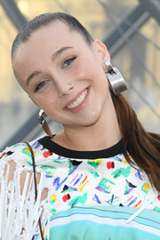 Emma Chamberlain rocked a pair of industrial-chic silver earrings.