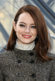 Emma Stone looked cute with her flippy 'do at the Louis Vuitton Fall 2019 show.
