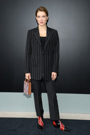 Lea Seydoux added a pop of color with a pair of red and black cowboy boots, also by Louis Vuitton.