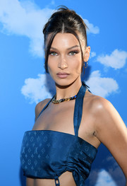 Bella Hadid attended the Louis Vuitton Menswear Fall 2020 show wearing her hair in a twisted bun.