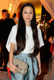 China Chow gave her sweet party look an exotic edge with a taupe snakeskin envelope clutch.