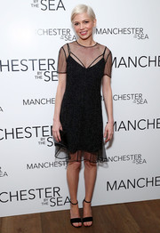 Michelle Williams donned a delicately beaded sheer-overlay LBD by Louis Vuitton for the special screening of 'Manchester by the Sea.'